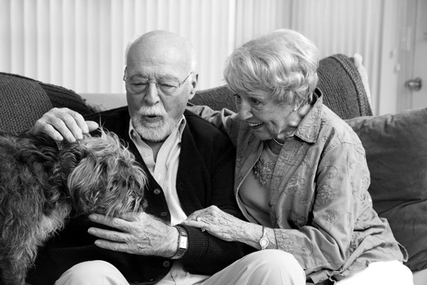 Senior Couple At Home With Their Dog