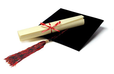 Image of a graduation cap and diploma earned by a veteran or servicemember.