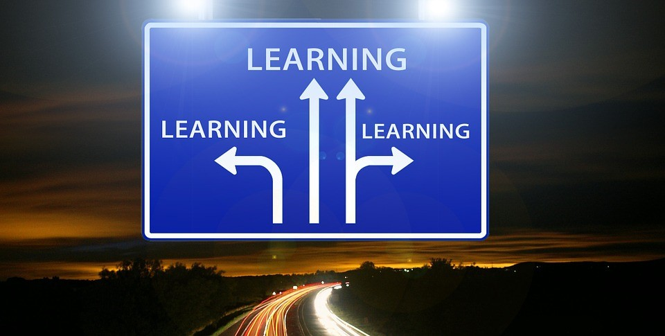 Image of a sign showing different paths to learning