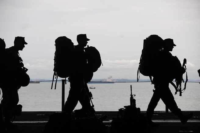 Image of men leaving for military duty