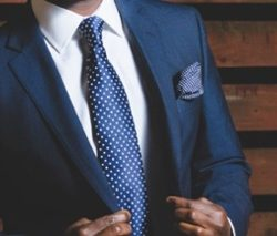 man-in-blue-suit-and-tie